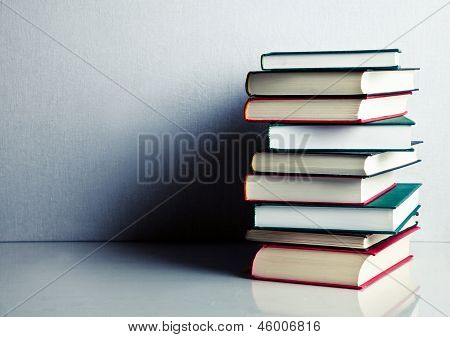 Stack Of Books On White Reflective Surface