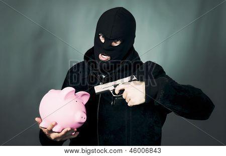 Man With A Gun And Piggy Bank