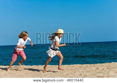 Boy Chasing Girlfriend On Beach.