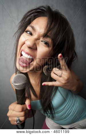 Beautiful Young Singer Sticking Out Her Tongue