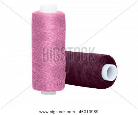 Two Coloured Spools Of Threads