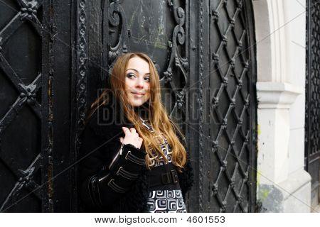 Girl At Black Door