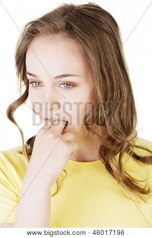 Woman putting her finger in her mouth to provoke vomiting isolated on white background