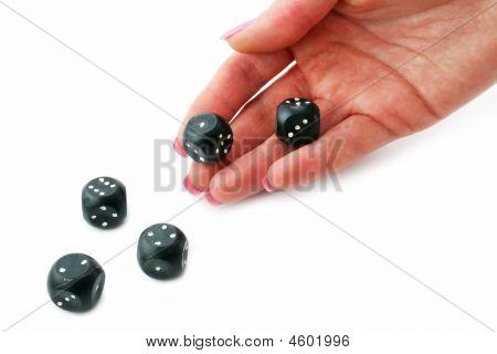 Female Hand Rolling Black Dice