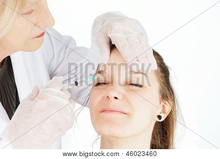 Young Woman Getting injection In Her Frown