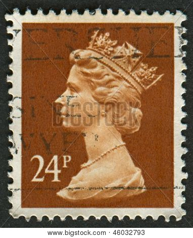 UK-CIRCA 1989: A stamp printed in UK shows image of Elizabeth II is the constitutional monarch of 16 sovereign states known as the Commonwealth realms, in Indian Red, circa 1989.