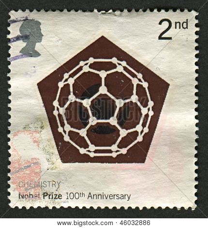 UK - CIRCA 2001: A stamp printed in UK shows image of the Carbon 60 Molecule (Chemistry), Centenary of Nobel Prizes, circa 2001.