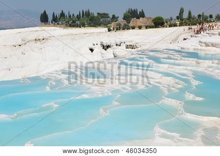 PAMUKKALE, TURKEY - AUGUST 18: Crowds of tourists on travertine terraces in Pamukkale, Turkey on August 18, 2011. Pamukkale included in the UNESCO World Heritage list since 1988