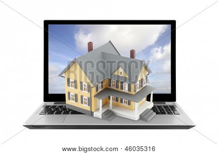 Yellow house on laptop isolated on white