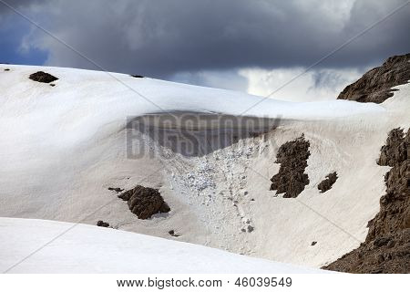 Snow Cornice In Mountains