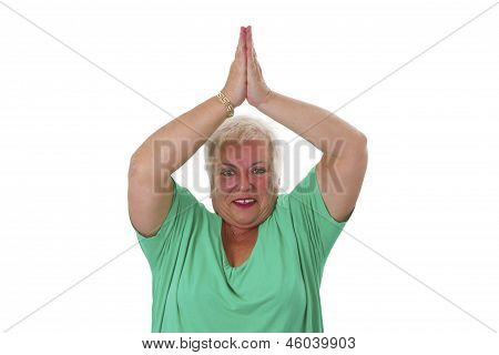 Female Senior In Yoga Meditating