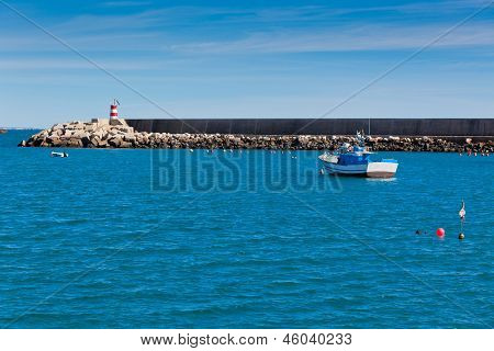 Pier With Small Lighthouse At Sagres, Portugal