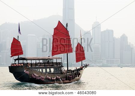HONG KONG - OCTOBER 8: A Junk ship in Victoria Harbor October 8, 2012 in in Hong Kong, SAR. Junk ships were used as seagoing vessels as early as the 2nd century AD.
