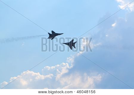 ZHUKOVSKY - AUGUST 12: Two Russian mig-29 aircrafts at airshow on 100th anniversary of Russian Air Force on August 12, 2012 in Zhukovsky, Moscow region, Russia.
