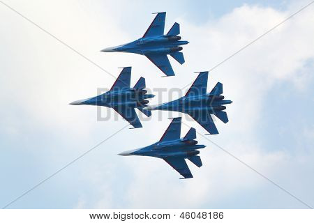 ZHUKOVSKY - AUGUST 12: Aerobatic group Strizhi from Russia at airshow on 100th anniversary of Russian Air Force on August 12, 2012 in Zhukovsky, Moscow region, Russia.