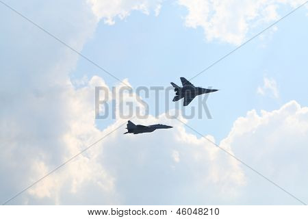 ZHUKOVSKY - AUGUST 12: Two Russian pilots at mig-29 aircrafts at airshow on 100th anniversary of Russian Air Force on August 12, 2012 in Zhukovsky, Moscow region, Russia.