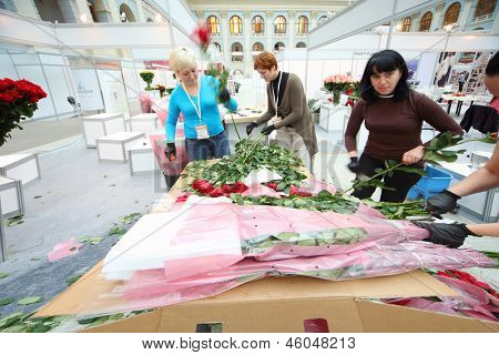MOSCOW - SEPTEMBER 4: Women make bouquets for XIX International Flower Show in Gostinnyj dvor, on September 4, 2012 in Moscow, Russia.