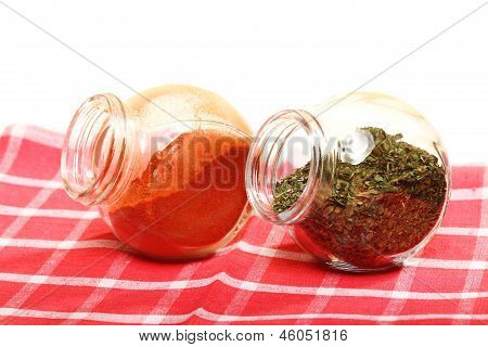 Jars With Spices Paprika And Lovage Isolated