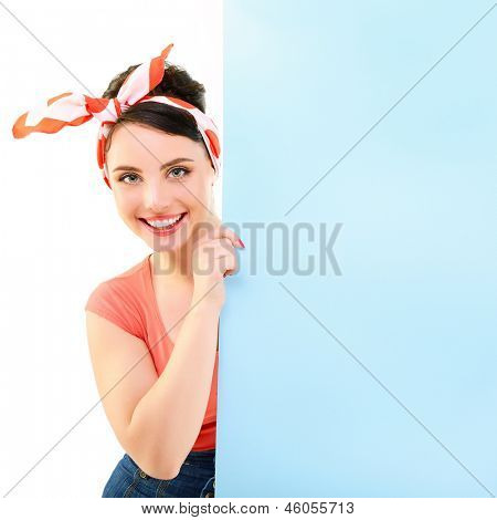 Pinup girl holding empty banner, portrait of young happy sexy woman in pin-up style