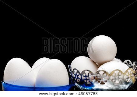 White Eggs In Glass Bowl, Basket, Front Lit, Isolated, Black Background, Copy Space