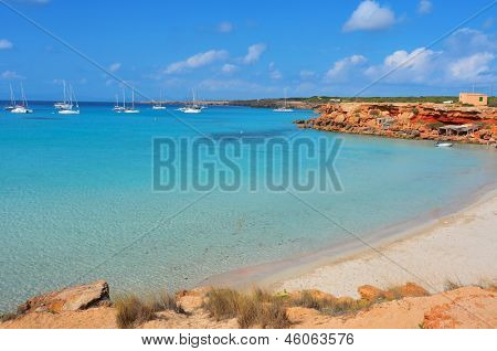 view of Cala Saona Beach, the mediterranean Sea and the typical slipways and fishermen huts, called barraques, in Formentera, Balearic Islands, Spain