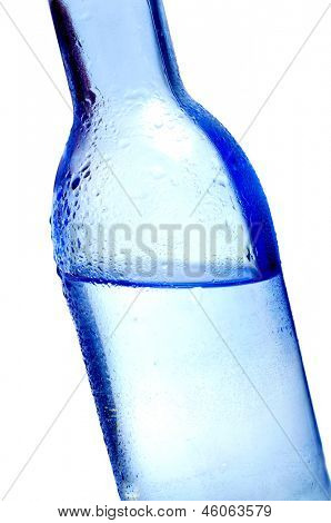 closeup of a bottle of water on a white background