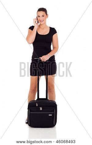 young female business traveler talking on cell phone isolated on white