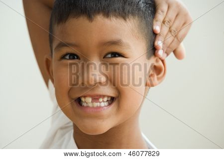 Young boy showing off the gap in his teeth