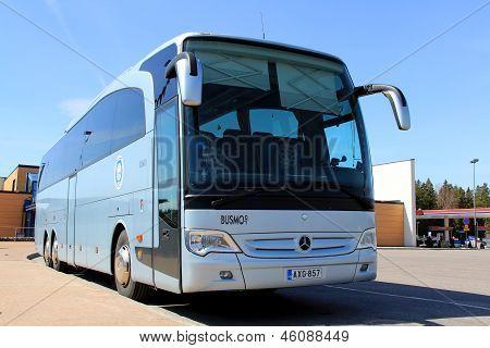 Blue Mercedes Benz Bus On A Bus Stop