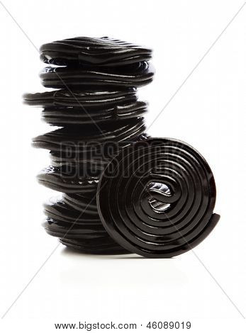Stack of liquorice reels isolated on white
