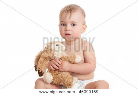 Baby With A Toy In Hands