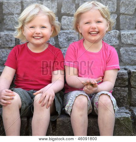 Laughing Cute Identical Twins