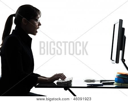 one business woman computer computing typing surprised  silhouette studio isolated on white background