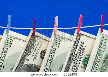 Hundred Dollars Hanging On A Clothesline. Money Laundering Concept