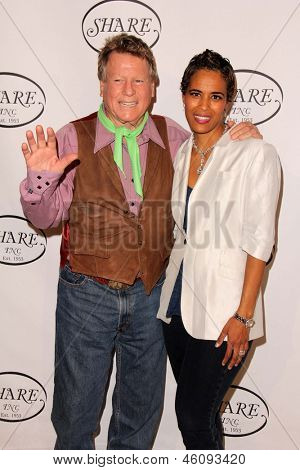 LOS ANGELES - MAY 11:  Ryan O'Neal, Daphne Wayans arrives at theSHARE 60th Annual