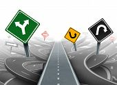stock photo of maze  - Avoiding distractions and clear strategy for solutions in business leadership with a straight path to success choosing the right strategic plan with yellow green black and red traffic signs through a maze of highways - JPG