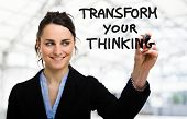 stock photo of transformation  - Businesswoman writing a motivational concept on the screen - JPG