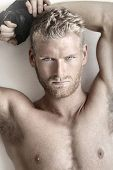 foto of macho man  - Highly detailed fashion portrait of a sexy muscular shirtless male model - JPG