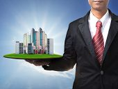 stock photo of penthouse  - business man and real estate in hand use for property land management and building construction theme - JPG