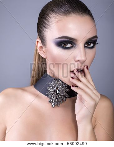 beautiful girl with smokey eyes make up