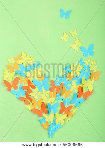 Paper butterflies on green wall