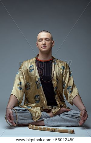 Image of yoga guru meditates in studio