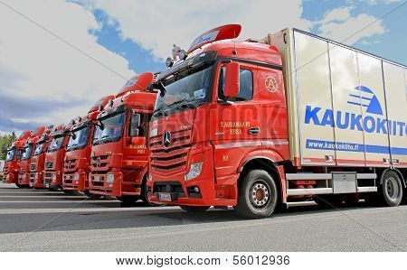 Fleet Of Red Long Haulage Trucks