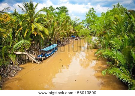 Water cannal with Boats in Mekong delta, Ben Tre, Vietnam.