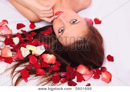 Woman Laying In A Bed
