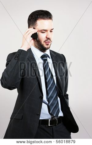 Young Bussinessman Talking On The Phone