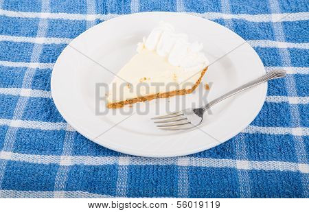 Lemon Or Lime Pie On Plate With Fork