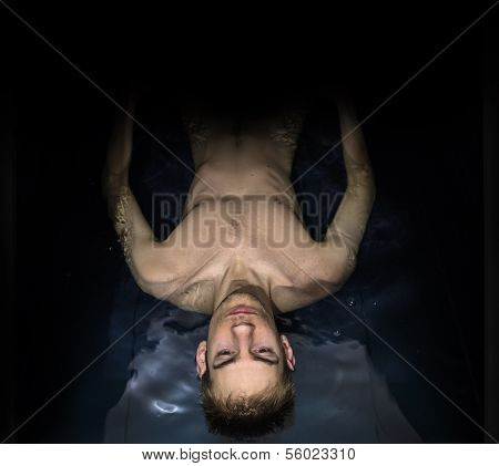 Man Floating In A Sensory Deprivation Isolation Tank