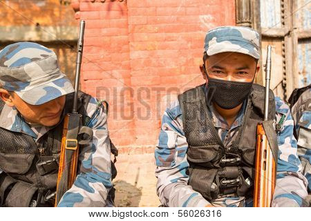 KATHMANDU, NEPAL - Oct 19: Unknown nepalese soldiers Armed Police Force near public school, Dec 19, 2013 in Kathmandu, Nepal. Initially founded with a roster of 15,000 police and military personnel.