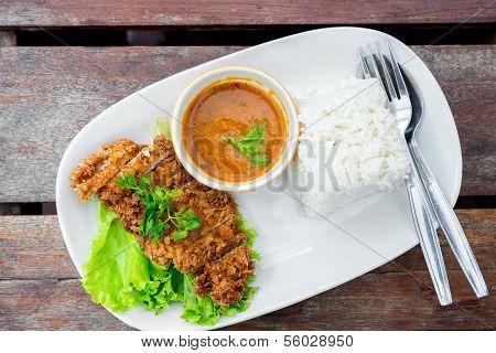 deep fried pork with rice on table